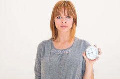 Woman holding alarm clock Royalty Free Stock Photo