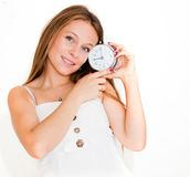 Woman holding alarm clock Stock Photo