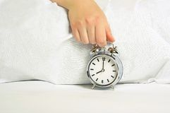 Woman holding  the alarm clock Royalty Free Stock Photos