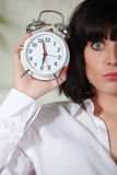 Woman holding alarm clock Stock Photography