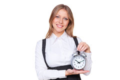 Woman holding the alarm clock Stock Photo
