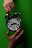 Woman holding alarm clock Royalty Free Stock Photo