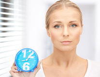 Woman holding alarm clock Royalty Free Stock Images
