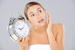 Woman holding an alarm clock Royalty Free Stock Image