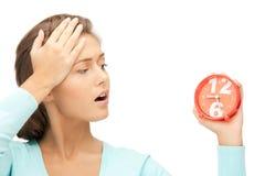 Woman holding alarm clock Stock Photography