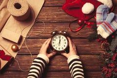 Woman holding alarm clock Stock Photos