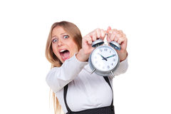 Woman holding alarm clock in panic. Isolated on white background Royalty Free Stock Images