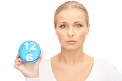 Woman holding alarm clock Stock Images