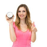 Woman holding alarm clock with thumbs up Stock Photos