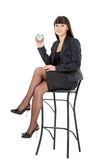 Woman holding alarm sitting on chair Royalty Free Stock Images