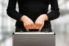 woman holding an aluminium briefcase Royalty Free Stock Photography