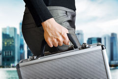 woman holding an aluminium briefcase Royalty Free Stock Photos