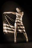 Woman holding an american flag. The woman holding an american flag Stock Photography
