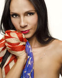 Woman holding American flag. Beautiful young woman holding American flag isolated against white background Stock Image