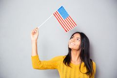 Woman holding american flag Royalty Free Stock Photography