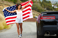 Woman holding American Flag Stock Photography