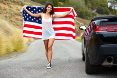 Woman holding American Flag Stock Images