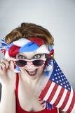 Woman holding American flag Royalty Free Stock Image