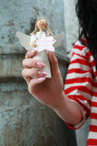 Woman holding an angel royalty free stock photo