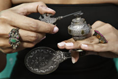 Woman holding an antique Middle Eastern make-up bo Royalty Free Stock Images