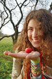Woman holding an apple Stock Image