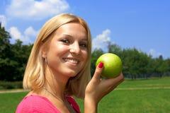 woman holding apple Stock Photos