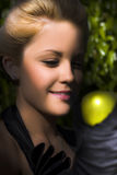 Woman holding apple Royalty Free Stock Photography