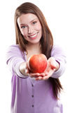 Woman holding an apple Royalty Free Stock Photography