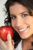 Woman holding an apple Stock Photography