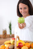 Woman holding a apple Royalty Free Stock Photo