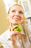 Woman holding apple Royalty Free Stock Images