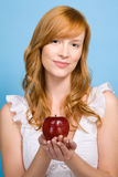 Woman holding an apple Stock Images