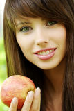Woman holding apple. Royalty Free Stock Photo