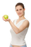 Woman holding apple Stock Photos