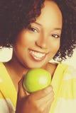 Woman Holding Apple Royalty Free Stock Photos