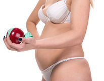 Woman holding apple and centimeter Royalty Free Stock Photography