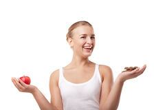 Woman holding apple and chocolate isolated Stock Photography