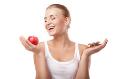 Woman holding apple and chocolate isolated Royalty Free Stock Image