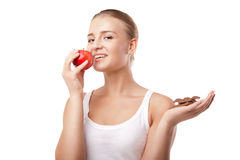 Woman holding apple and chocolate isolated Royalty Free Stock Images