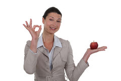 Woman holding an apple royalty free stock photo