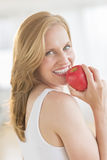 Woman Holding An Apple In House Royalty Free Stock Image