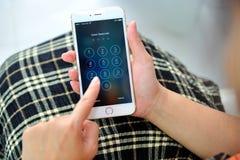 Woman holding Apple iPhone 6S plus Stock Photo