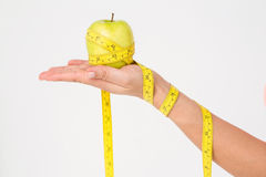 Woman holding apple with measuring tape Royalty Free Stock Photo
