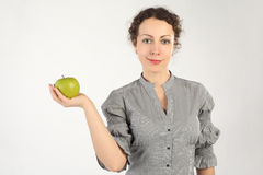 Woman holding an apple in one hand Royalty Free Stock Image