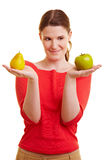 Woman holding apple and pear Stock Photos