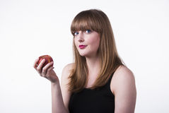 Woman holding apple. Pretty young woman holding an apple. Shot on white background Royalty Free Stock Image