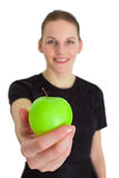 Woman Holding An Apple And Smiling. Woman Holding A Green Apple And Smiling Royalty Free Stock Photos