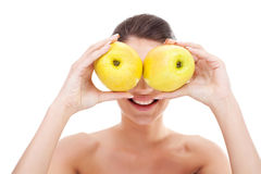 Woman holding apples over her eyes Stock Image