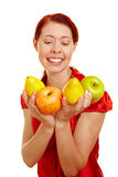 Woman holding apples and pears stock image