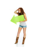 Woman holding an arrow pointing left Royalty Free Stock Photo